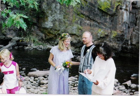 Dean and Colleen, getting married.  Saint Vrain River at the Folks Fest music festival in Lyons, Colorado.
